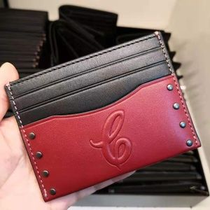 COACH SLIM CARD CASE SIGNATURE MOTIF AND STUDS